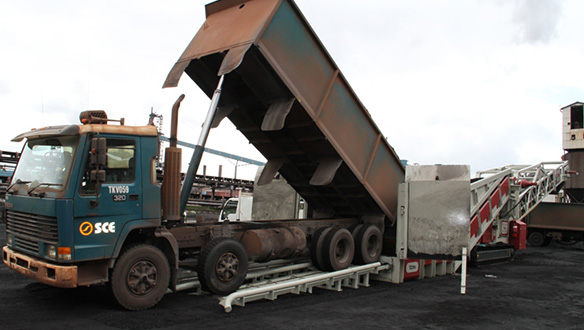 mobile-truck-unloader-loading-iron-ore-to-barge-from-trucks